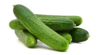 a stock image of five unmilked cucumbers