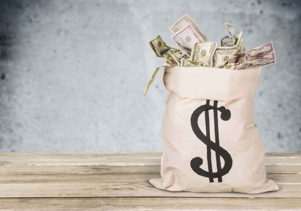stock image of a sack full of money