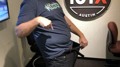 jason in studio, hold in his pants out to demonstrate how much weight he's lost