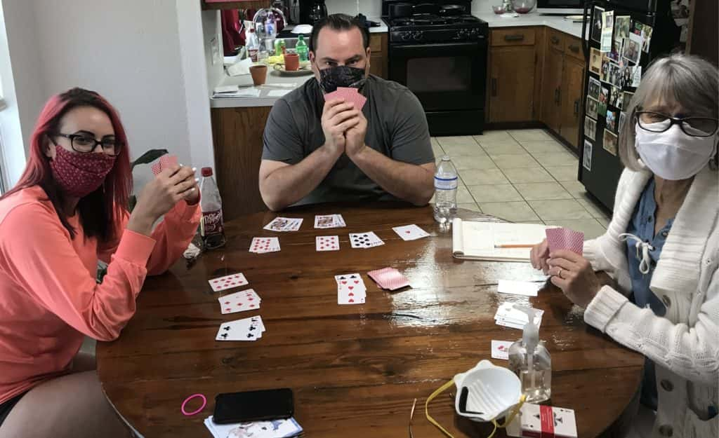 producer nick playing cards with his mom and sister on mother's day