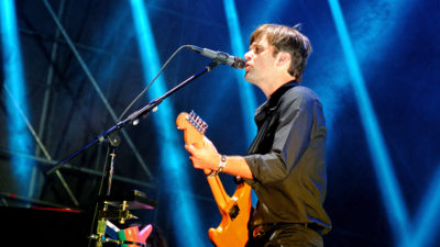 Ben Gibbard performing on stage