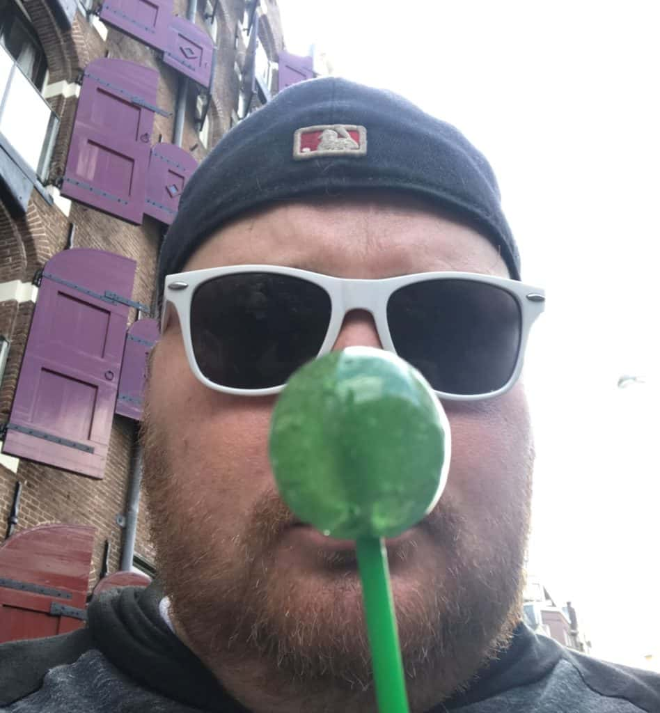Jason holding a CBD infused lollipop in Amsterdam