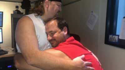 Nick and Jason having a solid bro hug in the studio