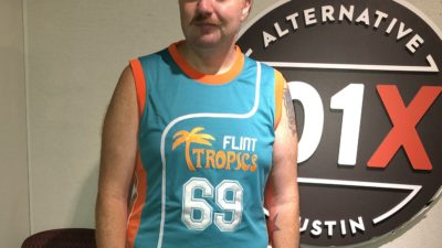 jason wearing a basketball jersey from the movie Semi-Pro in the studio