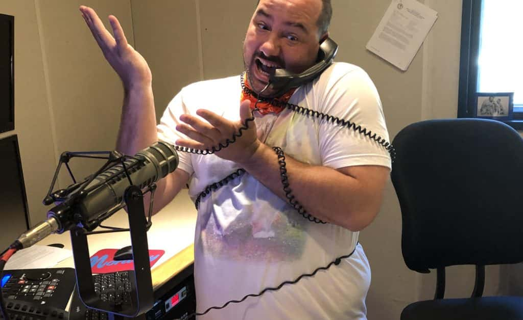 nick in studio with the phone cord wrapped around his torso