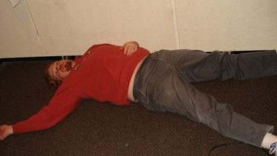 jason laying on the studio floor staring up at the ceiling