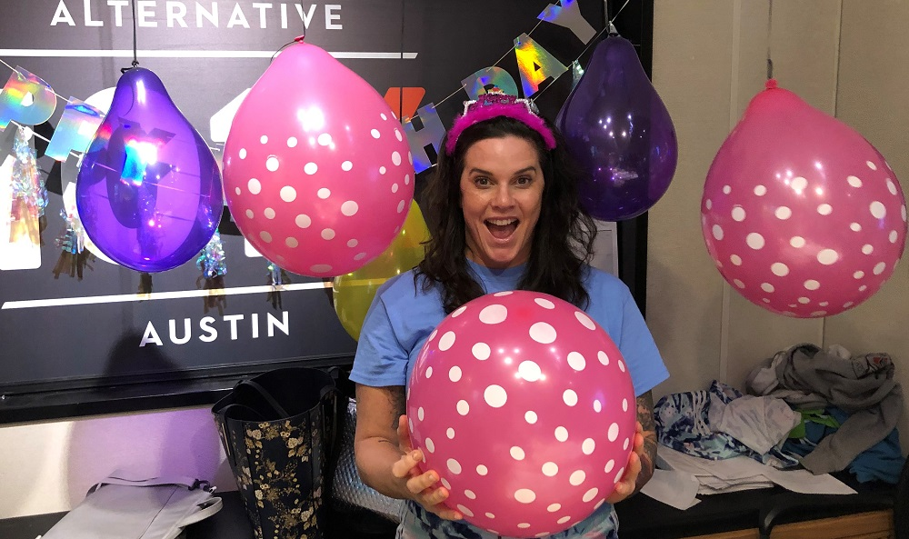 deb in the studio surrounded by birthday ballons