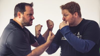 promotional photo of Jason and Nick facing off with their dukes up