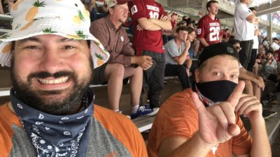 jason and nick sitting in the cotton bowl for texas ou