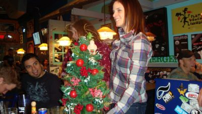 deb with a mini christmas tree at wahoo's fish tacos back in the day
