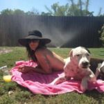 Deb sunbathing with Blue