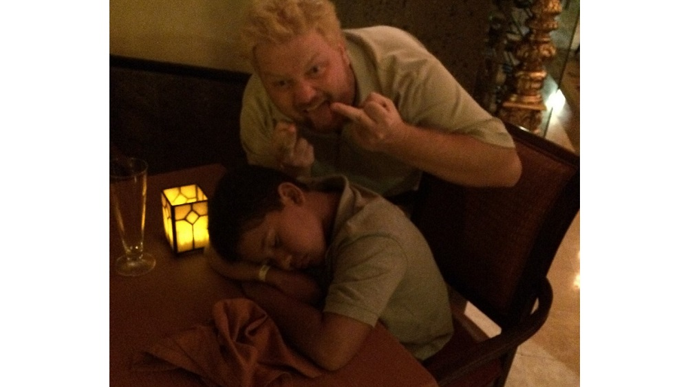 Jason flipping the bird at his nephew aiden who fell asleep at a restaurant table