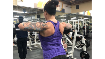 deb working out her back muscles in the gym