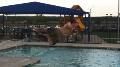 jason catching a football while jumping into the pool at the round rock express stadium