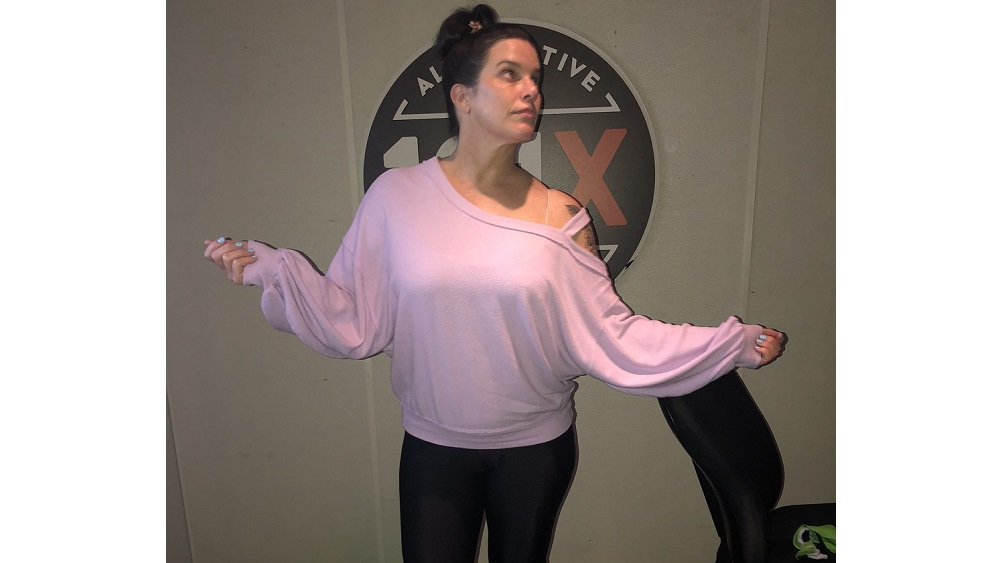 deb showing off her pink sweater that was named the c of the week