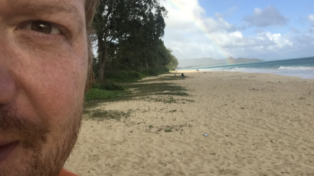 selfie of half of jason's face in front of a hawaiian beach