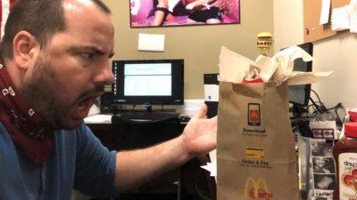 nick yelling at a mcdonald's bag full of napkins