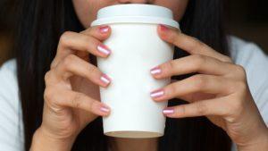 stock photo of woman slurping her coffee