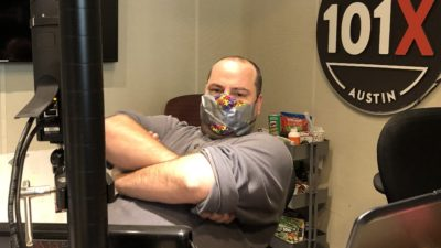 producer nick with his arms crossed and duct tape over his mouth