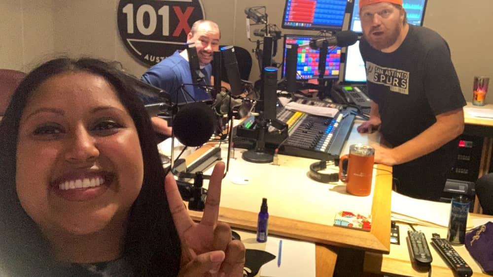 momo taking a selfie in studio with nick and jason in the background