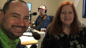 nick and jason's mom taking a studio selfie with jason in the background