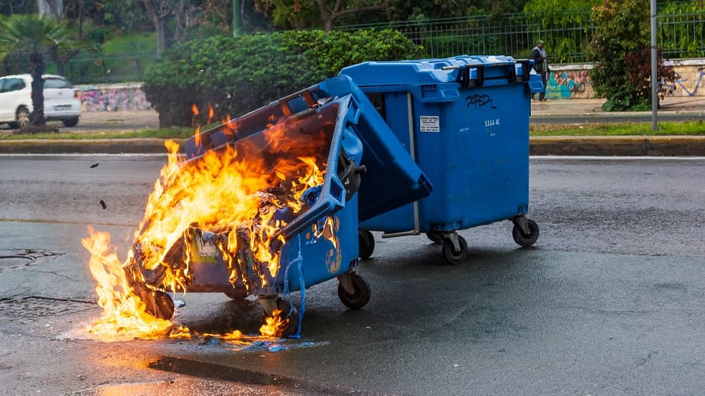 stock photo of a dumpster on fire