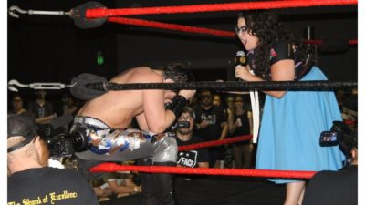 Roxy Castillo as a wrestling manager in the ring