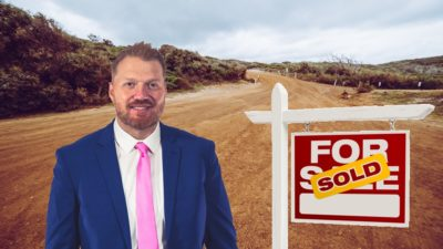 photoshop of jason in front of a dirt field next to a for sale sign