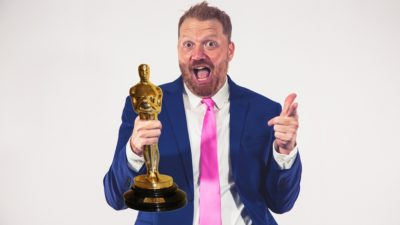 photo of jason in a suit with an academy award photoshopped into his hand