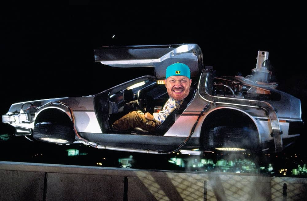 the DeLorean from back to the future with jason's face photoshopped onto Doc Brown's body