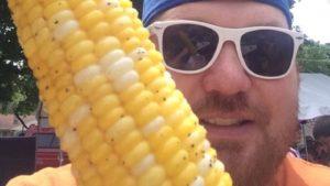 jason holding a corn on the cob