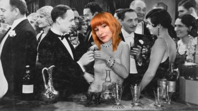emily's face photoshopped onto a stock photo of a fancy rich person's party