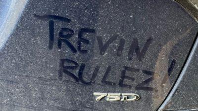 trevin rulez written in the dust on jason's tesla