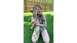 emily hugging her friends dog