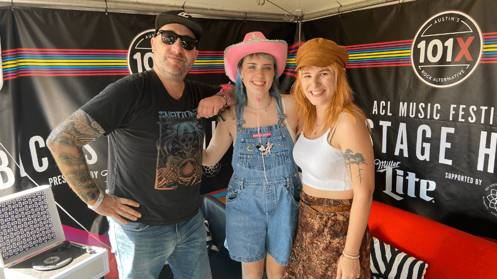 CJ Morgan and Emily standing with Frances Forever at the 101X ACL tent