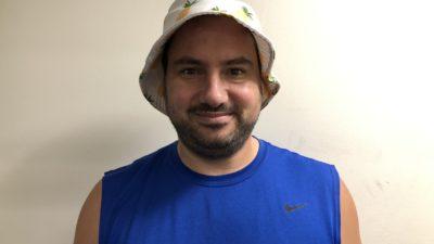 nick wearing a pineapple bucket hat