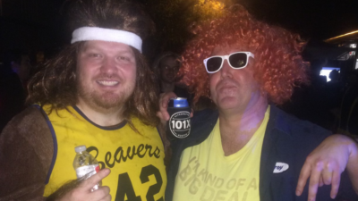 Jason dressed as teen wolf with a listener at a halloween party