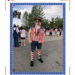 A man with red striped socks and an america shirt