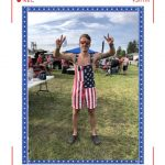 A man in an american flag overall