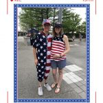 From left to right: man in usa flag onesie, woman in america shirt
