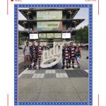 a group of men in america onesies standing infront of the pagoda at the ims
