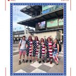 A group of men and women in an american flag outfit