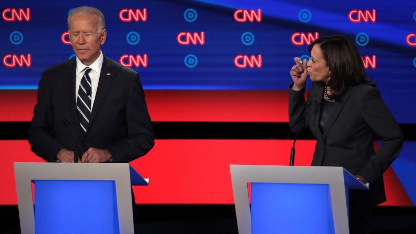 Democratic presidential candidate Sen. Kamala Harris (D-CA) (R) speaks while former Vice President Joe Biden listens.