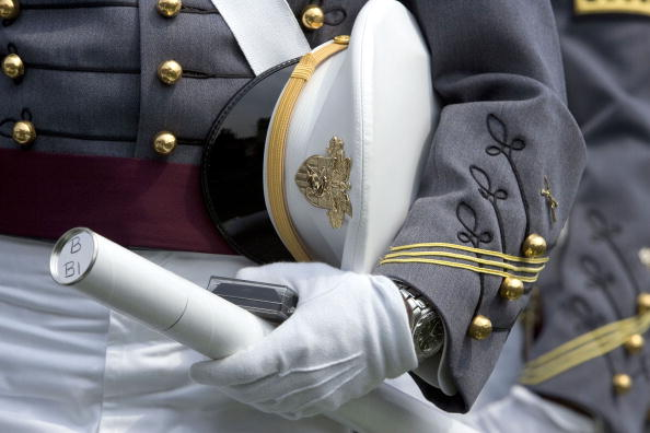 A West Point A cadet holds his diploma and cap during the graduation ceremony at the U.S. Military Academy .