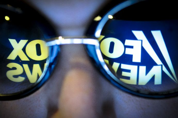 The Fox News logo is seen reflected in a pair of sunglasses on November 3, 2017.