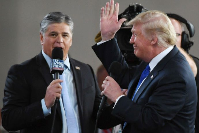 AS VEGAS, NV - SEPTEMBER 20: Fox News Channel and radio talk show host Sean Hannity (L) interviews U.S. President Donald Trump b