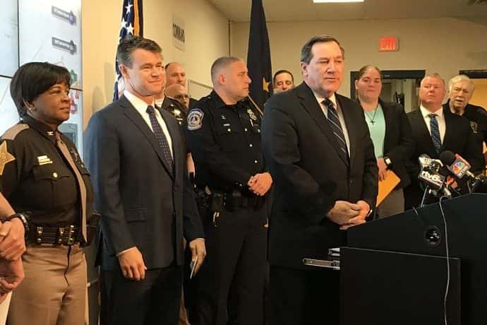 File photo of Sens. Todd Young and Joe Donnelly, standing with group of police officers (Berman/WIBC)