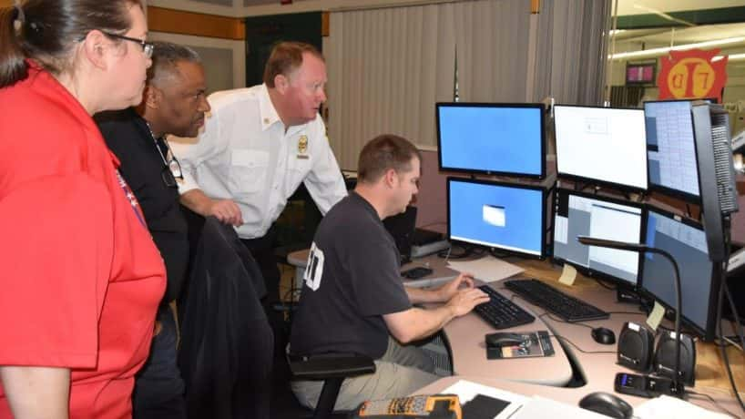 Dispatchers view monitors with upgraded public safety computers (IFD Photo)