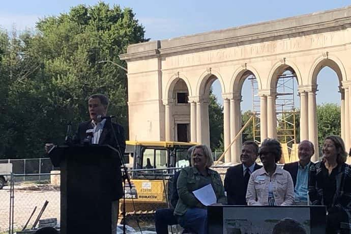 Indianapolis Mayor Joe Hogsett speaks in front of the memorial to one of his predecessors, Thomas Taggart. in 2019. The memorial now forms part of the new Taggart Amphitheater.