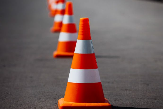 Orange Cones Sit Upon a Freeway. Traffic in Indianapolis is going to be hell this weekend.